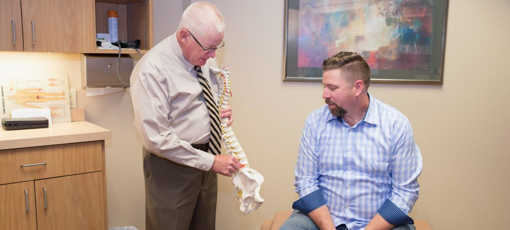 Patient in Springfield, MO being shown sciatica treatment options from chiropractor